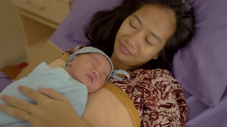 предродовой : Asian happy mother with newborn baby resting
