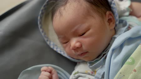 newborn child : Asian newborn baby laying in crib Stock Footage