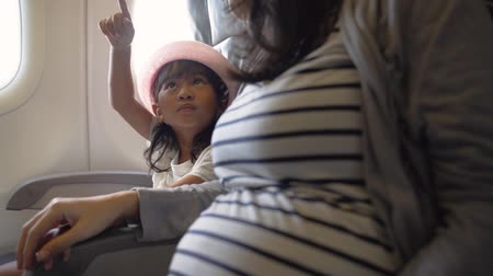 mei : young mother and her daughter enjoy the flight Stock Footage