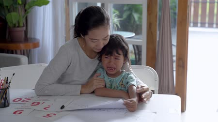 desperate student : mother comfort her crying daugther at home Stock Footage