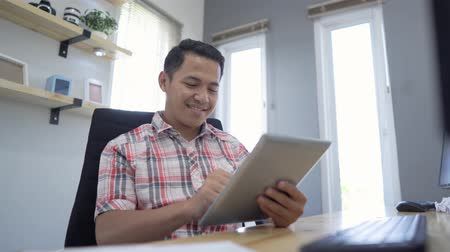 tab : business owner relaxing using tablet at his office Stock Footage