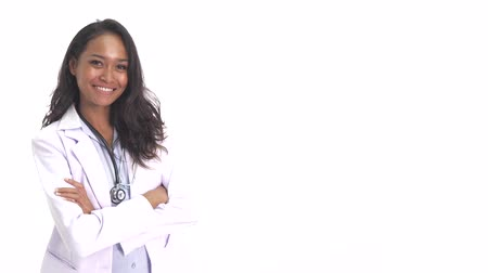 copyspace : beautiful young doctor smiling with arm crossed