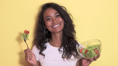 salad : healthy young woman eating a bowl of vegetable salad Stock Footage