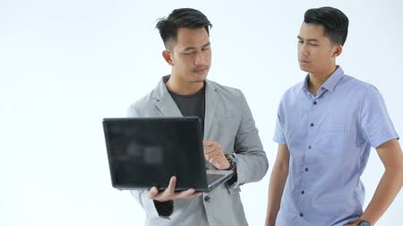 seriously : Asian Young Business team with laptop Stock Footage