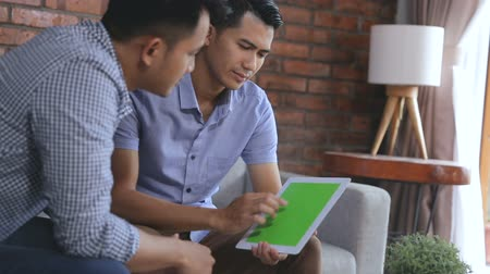 tab : discussing about something at home using tablet Stock Footage