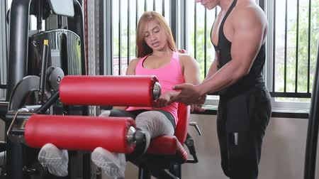 indonesian : Gym leg extension exercise workout woman Stock Footage