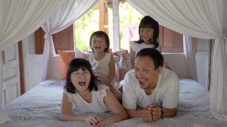cenefa : Asian happy family and child daughter laughing together