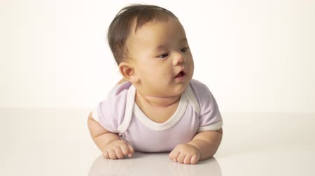 baby chubby : baby is on his stomach development Stock Footage
