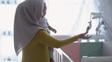 muslim mother play with her child 動画素材