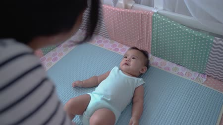 asian happy baby on the crib 動画素材