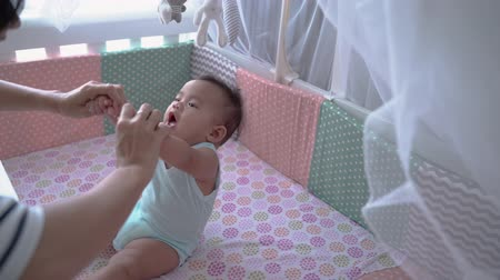 asian happy baby on the crib Stok Video