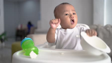 milestone : asian baby boy sitting on high chair Stock Footage