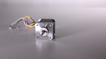 flange : The stepper motor is on the white table. Stock Footage