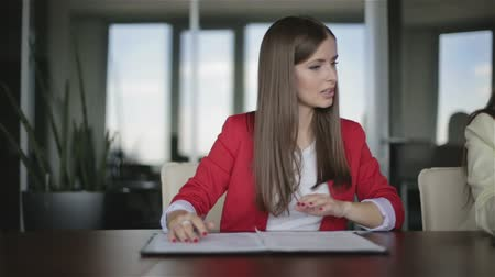 jurist : Two business women are working in the office Stock Footage