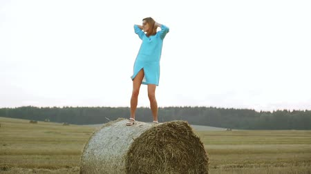 imitates : Beautiful young woman dancing in a haystack.