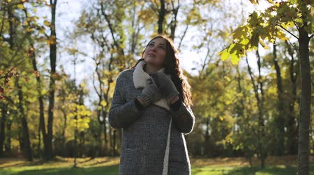 mittens : Beautiful woman freezing in autumn park.