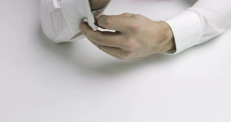 undo : 4K Close-up of mans hands removed cufflinks on his white shirt Stock Footage