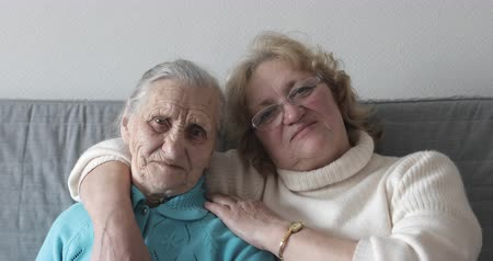 caregiver : Old women portrait with happy mom and daughter hugging. Stock Footage