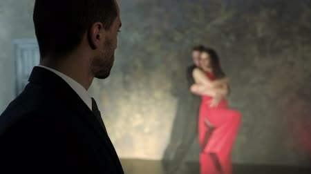 tutku : A rich man looks at a couple dancing tango.