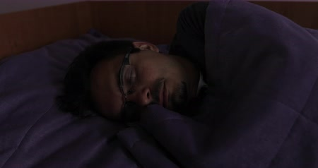 stylization : A sick man with glasses and a beard asleep in the bed