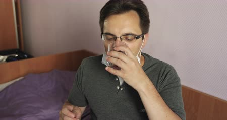 stylization : Very sick man drinks a medicine during the epidemic. Stock Footage