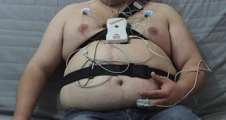 porky : Very fat man with sensors on his body.