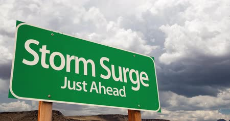4K Time-lapse Storm Surge Green Road Sign and Stormy Cumulus Clouds and Rain. Stok Video