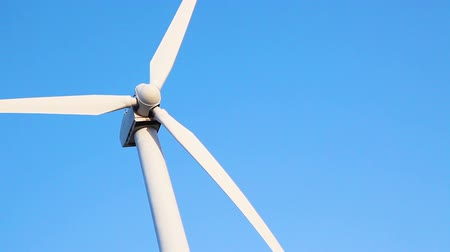 Looping Cinemagraph of Wind Turbine Against Blue Sky
