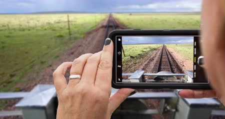 4k Looping Cinemagraph of Woman Filming Train Ride on Smart Phone .