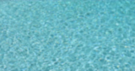 4k Looping Seamless Cinemagraph of Blurred Fresh Swimming Pool Water Background.