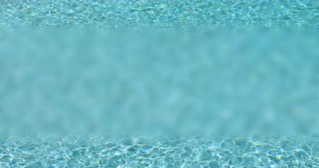 4k Looping Seamless Cinemagraph of Blurred Middle Section Fresh Swimming Pool Water Background.