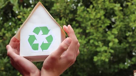 sustain : House with recycling symbol. People, ecology, environment and conservation concept - close up of hands holding house with green recycling sign Stock Footage