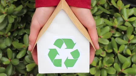 sustain : Hands Holding House With Green Recycling Sign. People, ecology, environment and conservation concept - close up of hands holding house with green recycling symbol