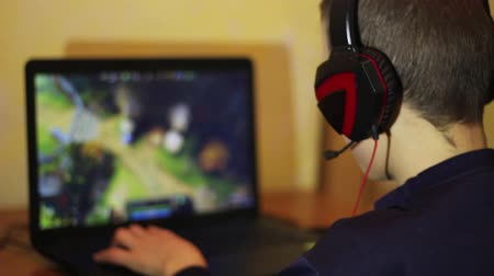 heroes : E-sports. A boy playing a strategy video game. Multiplayer online battle arena (MOBA), also known as action real-time strategy (ARTS)