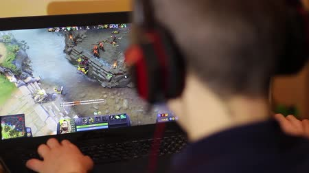 gameplay : Dota 2 is a free-to-play multiplayer online battle arena video game. E-games. Gamer Playing In Dota-2