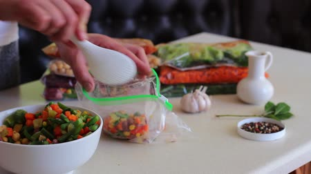 blanching : Packing Vegetables for Freezing. Freezer safe bags. Healthy Freezer Meals Stock Footage