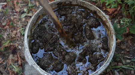 rothadó : Fermentation of animal manure. Compost tea from manure, best garden plants fertilizer Stock mozgókép