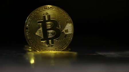 mining farm : Bitcoin cryptocurrency. Bitcoins mining. Bitcoin is a worldwide cryptocurrency and digital payment system. Black background Stock Footage