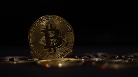 mining farm : Bitcoin is a worldwide cryptocurrency and digital payment system. Black background Stock Footage