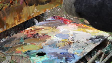 palette knife : The artists palette close-up. Mixing oil paints