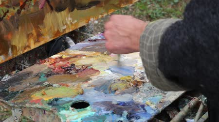palette knife : The artists palette close-up. Mixing oil paints. The artists palette close-up. Mixing oil paints Stock Footage
