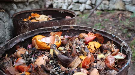 biodegradable : Home compost barrel. Heap of wet organic matter known as green waste (leaves, food waste) and waiting for the materials to break down into humus Stock Footage