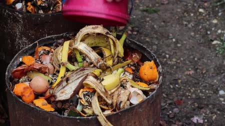 biodegradable : Home compost barrel. Waste sorting. Materials in a compost pile Stock Footage