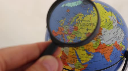 magnifier : Countries In Europe - Small Prints Map Elements Through A Magnifying Glass Stock Footage