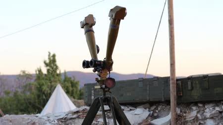 yakın : Army optics in the dugout. Military operations in real time. Military telescope at the funk-hole. Boxes of ammunition