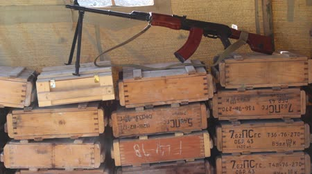 patron : Wooden boxes of weapons. Assault rifle. Boxes With Weapons And Ammunition In A Military Camp.