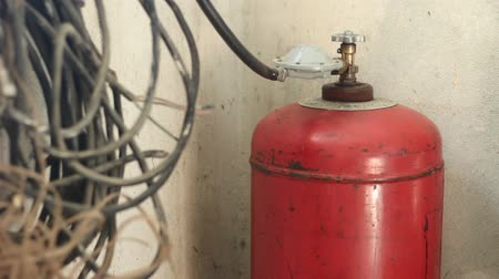 refining : A gas cylinder or tank is pressure vessel used to store gases at above atmospheric pressure. High-pressure gas cylinders are also called bottles. Propane is it flammable hydrocarbon gas, present in natural gas and used as bottled fuel. Gas Cylinder For Fo Stock Footage