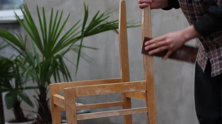 preserver : Paint Stripping. Hand-Sanding. Restoration of old chair. A Process Of Polishing A Wooden Board With Sandpaper Stock Footage