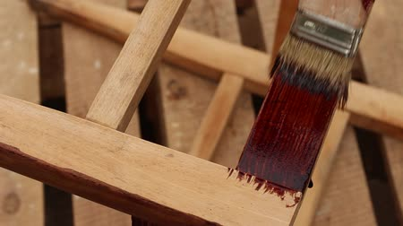 preserver : Wood Painting With A Brush. Wood painting with a brush in brown color