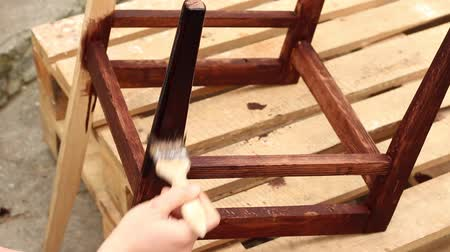 preserver : Furniture Restoration. Varnishing. Painting Wooden Chair With Brush Stock Footage